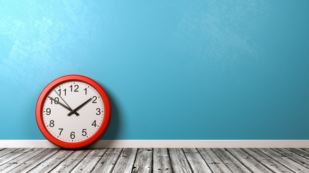 Red Clock on Wooden Floor Against Blue Wall with Copyspace 3D Illustration Reklamní fotografie