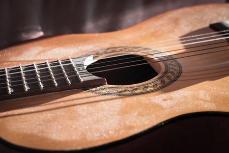 Classical Guitar Covered with Dust Close-up Stock Photo
