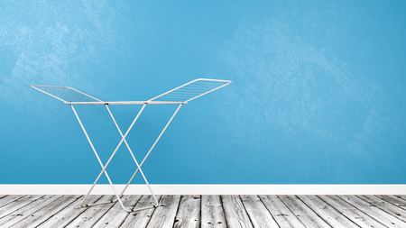 White Clothes Drying Rack on Wooden Floor Against Blue Wall with Copy Space 3D Illustration