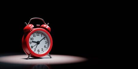 Red Classic Alarm Clock Spotlighted on Black Background with Copy Space 3D Illustration Reklamní fotografie