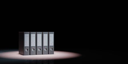 Set of Binders Spotlighted on Black Background with Copy Space 3D Illustration