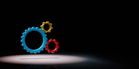 Three Plastic Colorful Gears Engaged Spotlighted on Black Background with Copy Space 3D Illustration 스톡 콘텐츠