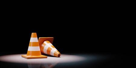 Two Orange Traffic Cones Spotlighted on Black Background with Copy Space 3D Illustration