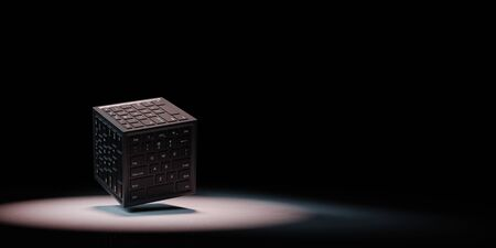 Cube Shape with Computer Keyboard on Faces Spotlighted on Black Background with Copy Space 3D Illustration