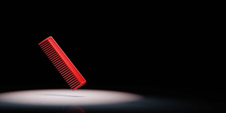 Red Comb Spotlighted on Black Background with Copy Space 3D Illustration