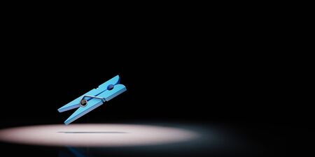 One Blue Plastic Clothespin Spotlighted on Black Background with Copy Space 3D Illustration Standard-Bild