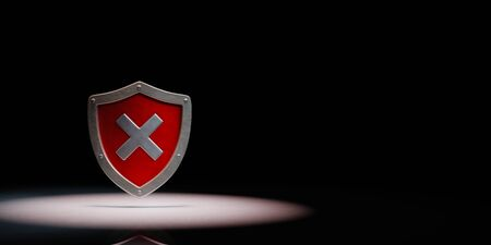 Metallic Shield Shape with Cross Spotlighted on Black Background