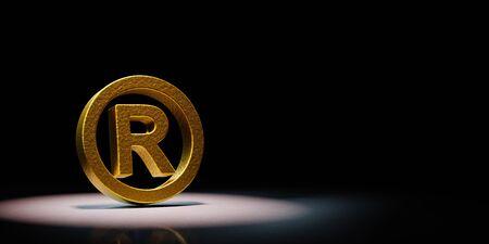 Golden Trademark Symbol Shape Spotlighted on Black Background with Copy Space 3D Illustration