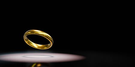 One Single Golden Ring Spotlighted on Black Background with Copy Space 3D Illustration 스톡 콘텐츠