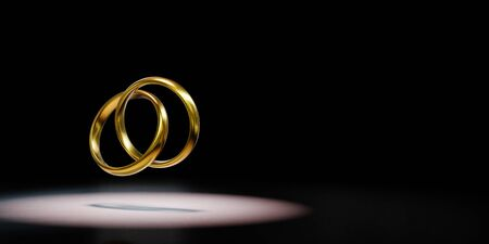 Two Golden Rings Chained Spotlighted on Black Background with Copy Space 3D Illustration