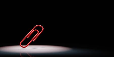 One Single Red Paperclip Spotlighted on Black Background with Copy Space 3D Illustration 스톡 콘텐츠