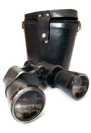 Photo of old binoculars, isolated on a white background photo