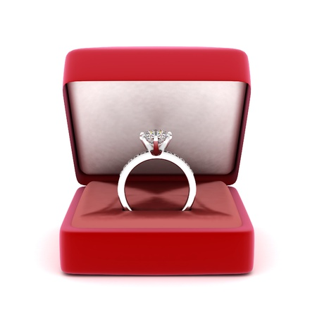 image of wedding rings in a gift box on white background