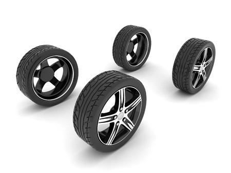 huellas de llantas: ruedas de la imagen deportiva con llantas de aleación sobre un fondo blanco Foto de archivo