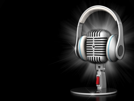 radio microphone: image of the old, chrome microphone on a black background Stock Photo