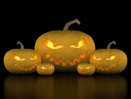 Image sinister pumpkins for Halloween on a black background photo
