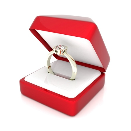 image of wedding rings in a gift box on white background photo