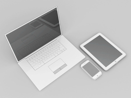 Laptop, tablet and smartphone on a gray background