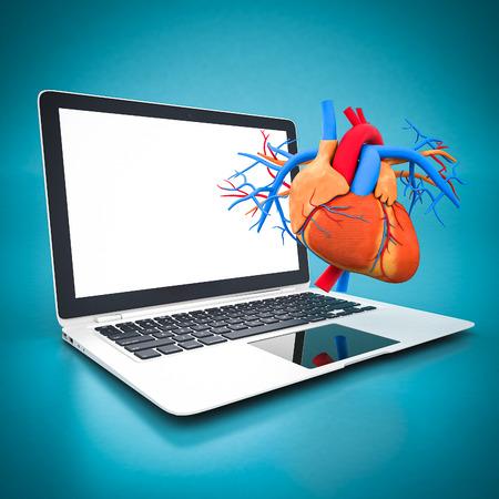 white laptop: modello del cuore e computer portatile bianco su sfondo blu Archivio Fotografico
