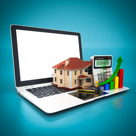 house, calculator and pen and white laptop on a blue background photo