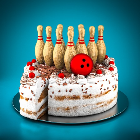 strike: Skittles for bowling and cake on a blue background Stock Photo
