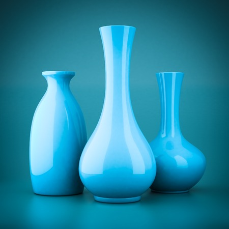beautiful homes: set of porcelain vases on a blue background