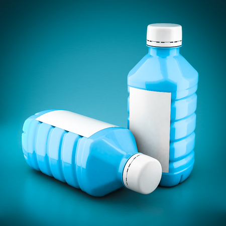 water bottles: Bottles of water on a beautiful blue background Stock Photo