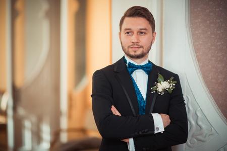 his shirt sleeves: Bridegroom preparing for the wedding, straightens his shirt sleeves