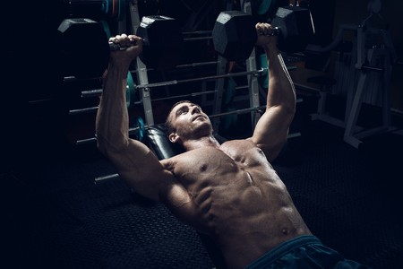latissimus: Male bodybuilder, fitness model trains in the gym Stock Photo