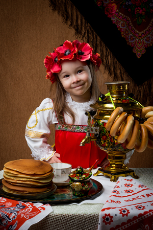 Pancake week. Spring holiday. Portrait of a girl in national costume.