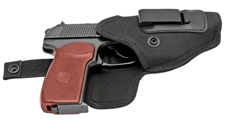 Russian handgun in a holster isolated on a white background photo