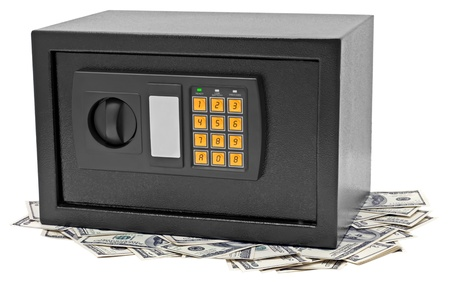 Metal safe is on hundred dollar bill. Isolated on white. photo