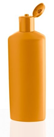 Orange shampoo bottle. Isolated on white background photo
