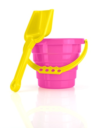 Childrens Sand Bucket and Shovel Isolated on White ground photo