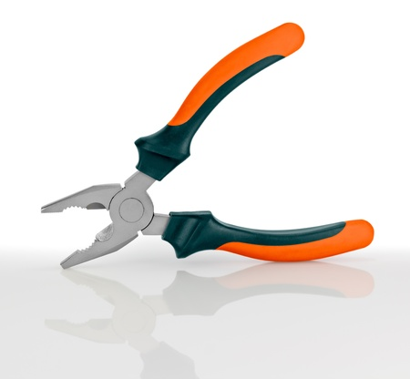 Studio photography of a pliers.  isolated on white background photo