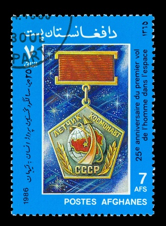 AFGHANES - CIRCA 1986: A stamp printed in Afghanes showing Medal Pilot Astronaut USSR circa 1986. photo