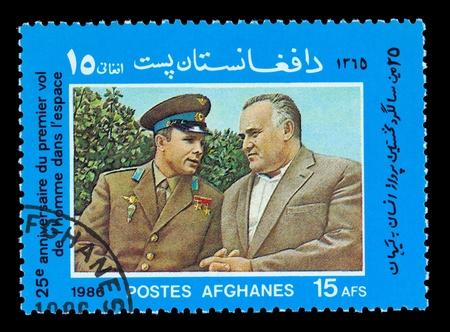gagarin: AFGHANES - CIRCA 1986: A stamp printed in the Afghanes shows Yury Gagarin and Sergey Koroliov, circa 1986