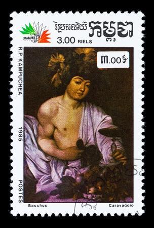 bacchus: KAMPUCHEA - CIRCA 1985. A stamp printed in Kampuchea (Kingdom of Cambodia) shows draw by artist Caravaggio - Bacchus, circa 1985 Stock Photo