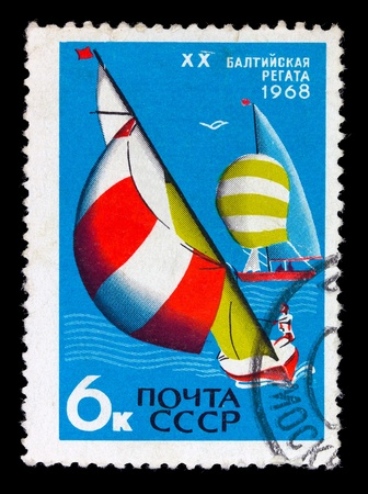 USSR - CIRCA 1968: A stamp printed in the USSR shows yachts regatta, devoted Olympic games, circa 1968 photo