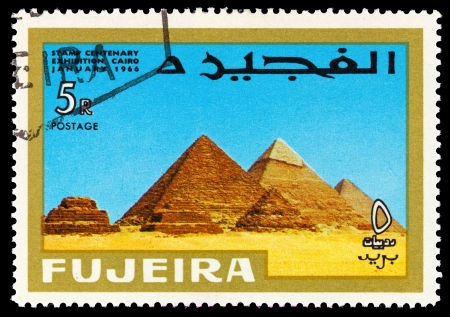 fujeira: FUJEIRA - CIRCA 1966: A stamp printed in Fujeira (UAE) shows Pyramids at Giza with inscription and name of the series Stamp Centenary Exhibition, Cairo, January 1966, circa 1966