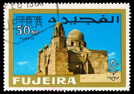 fujeira: FUJEIRA - CIRCA 1966: A stamp printed in Fujeira (UAE) shows First Christian church with inscription and name of the series Stamp Centenary Exhibition, Cairo, January 1966, circa 1966