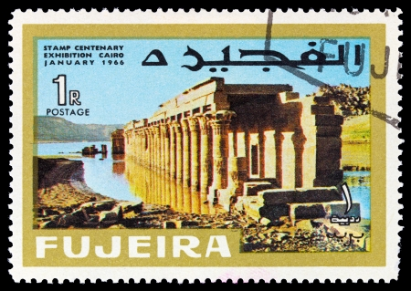 fujeira: FUJEIRA - CIRCA 1966: A stamp printed in Fujeira (UAE) shows Columns of the Great Temple at Philae with inscription and name of the series Stamp Centenary Exhibition, Cairo, January 1966, circa 1966