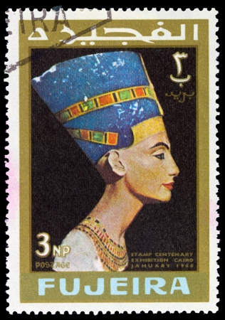 fujeira: FUJEIRA - CIRCA 1966: A stamp printed in Fujeira (UAE) shows Queen Nefertiti with inscription and name of the series Stamp Centenary Exhibition, Cairo, January 1966, circa 1966