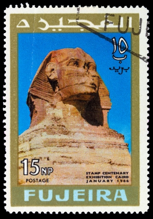 fujeira: FUJEIRA - CIRCA 1966: A stamp printed in Fujeira (UAE) shows Sphinx at Giza with inscription and name of the series Stamp Centenary Exhibition, Cairo, January 1966, circa 1966FUJEIRA - CIRCA 1966: A stamp printed in Fujeira (UAE) shows Sphinx at Giza wi