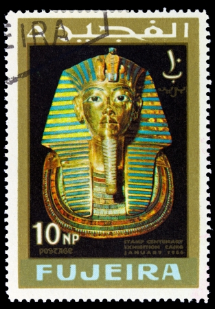 fujeira: FUJEIRA - CIRCA 1966: A stamp printed in Fujeira (UAE) shows Mask of Tutankhamen with inscription and name of the series Stamp Centenary Exhibition, Cairo, January 1966, circa 1966