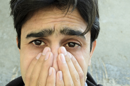 Portrait of a young man crying photo