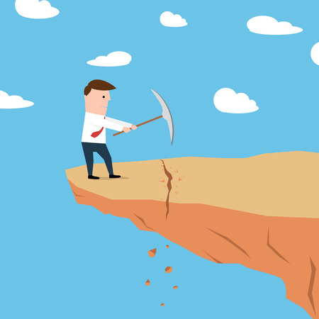 Man op een klif graven grond Stockfoto