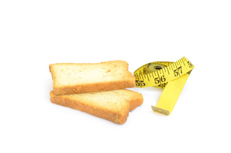 rusk: Rusk and measure tape. Weight loss concept.