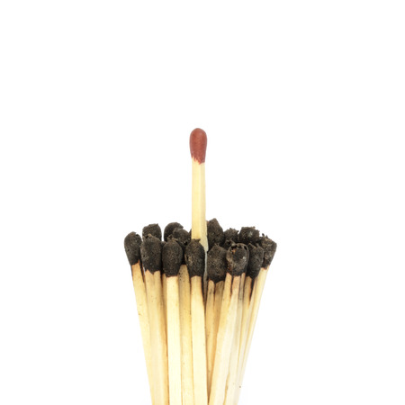 matchstick: Red matchstick among a bundle of burnt ones. Uniqueness and standing out from the crowd concept Stock Photo