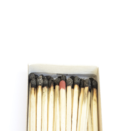 burnt out: Red matchstick among burnt ones. Uniqueness and standing out from the crowd concept Stock Photo